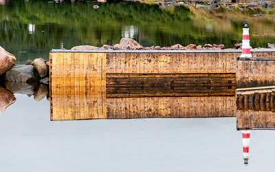 Wooden dock reflected on the water at Red Bay, Newfoundland and Labrador, Canada