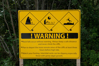 Warning sign near Joggins Fossil Cliffs in Nova Scotia, Canada