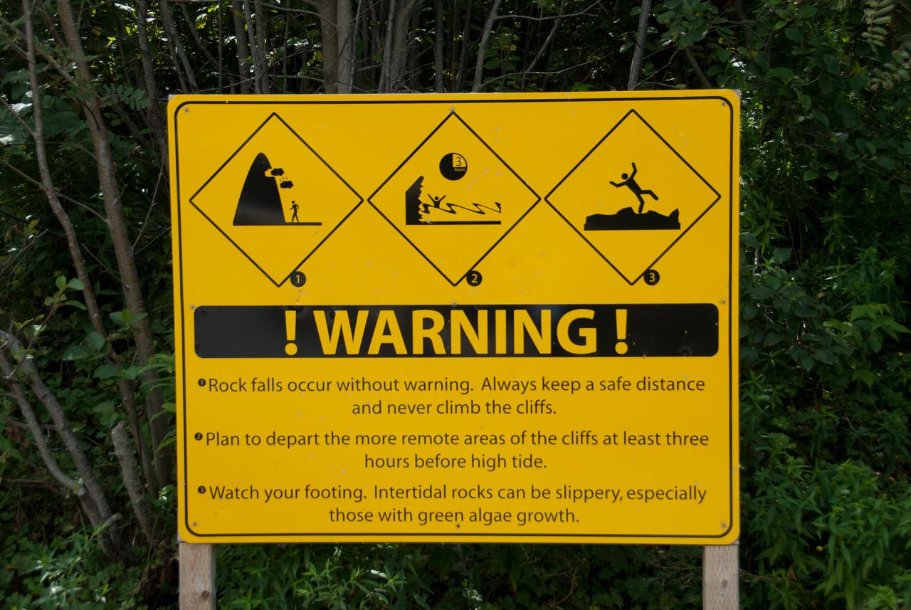 Warning sign near Joggins Fossil Cliffs in Nova Scotia, Canada