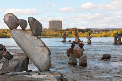 Balanced rock sculptures in Remic Rapids in Ottawa River, Ontario, Canada