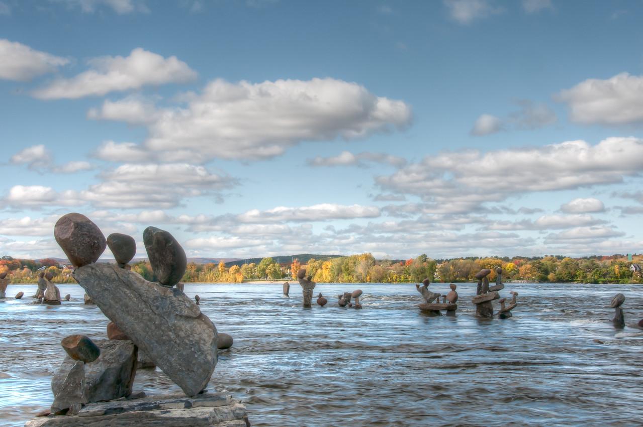 Balanced rock sculptures by John Ceprano in Ottawa River, Ontario, Canada