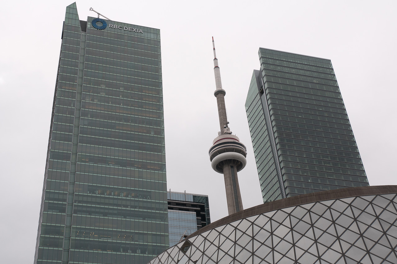 CN Tower in the middle of two high-rise buildings in Toronto, Canada