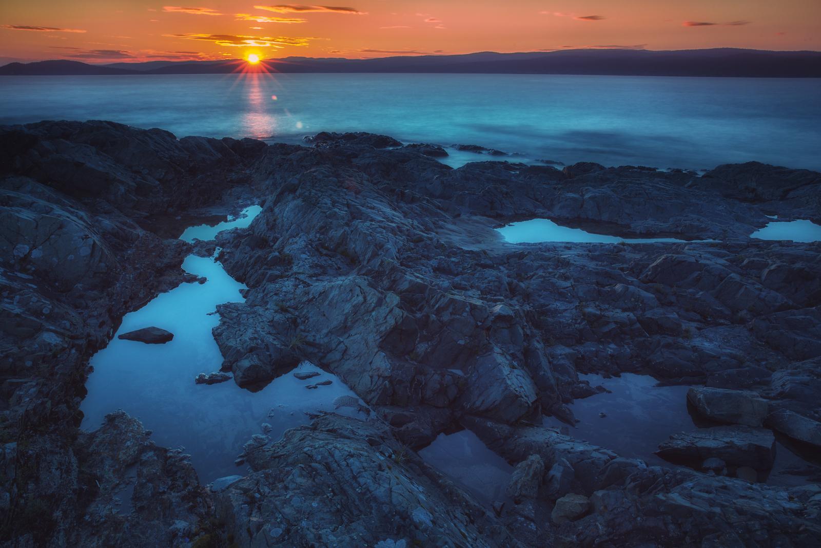 The sun sets at Rock Island Lodge on Lake Superior