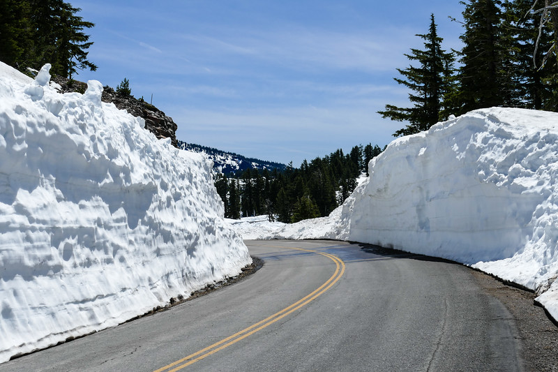 Roadway banked with snow in Crater Lake National Park.