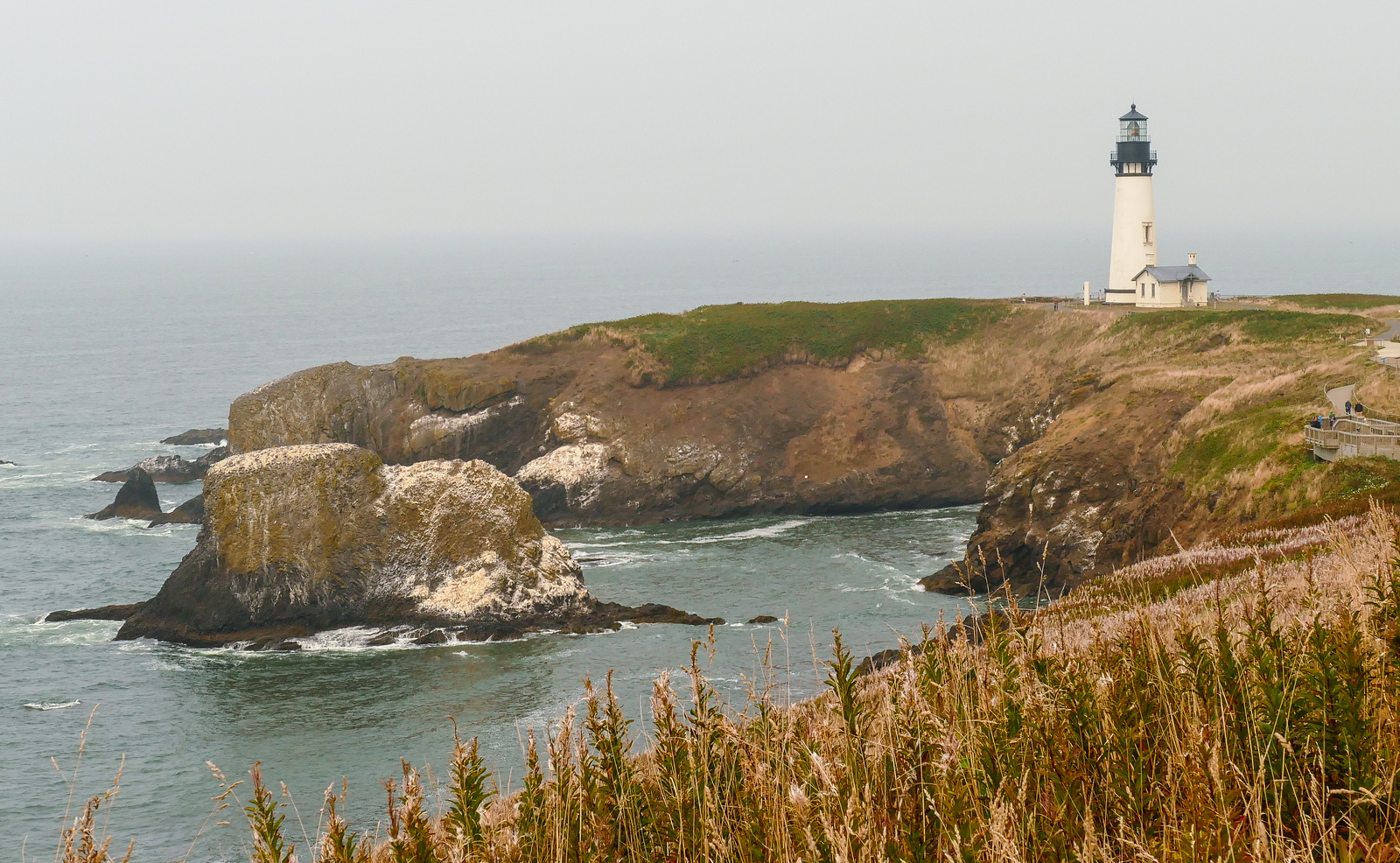 In Newport, Oregon, explore the history and beauty at Yaquina Head Lighthouse. #boomertravel #Oregon #Newport #lighthouse #travel #USA