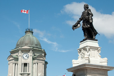 The old post office with its clock tower and monument to Samuel de Champlain, founder of Quebec City by Paul Chevré