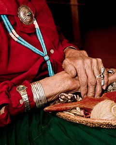 Old Navajo weaver with her tools