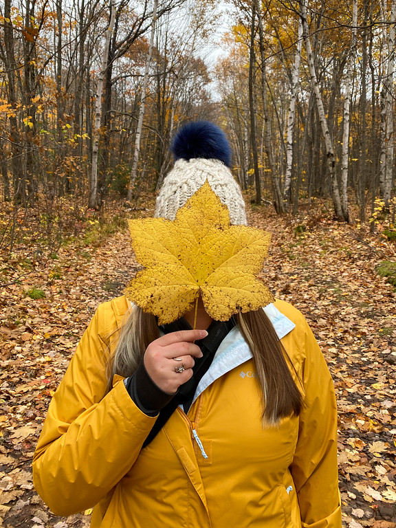 Amanda in a yellow raincoat with a huge yellow leaf