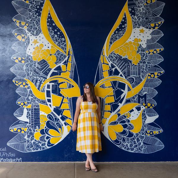 Amanda in front of Michigan wings in Ann Arbor