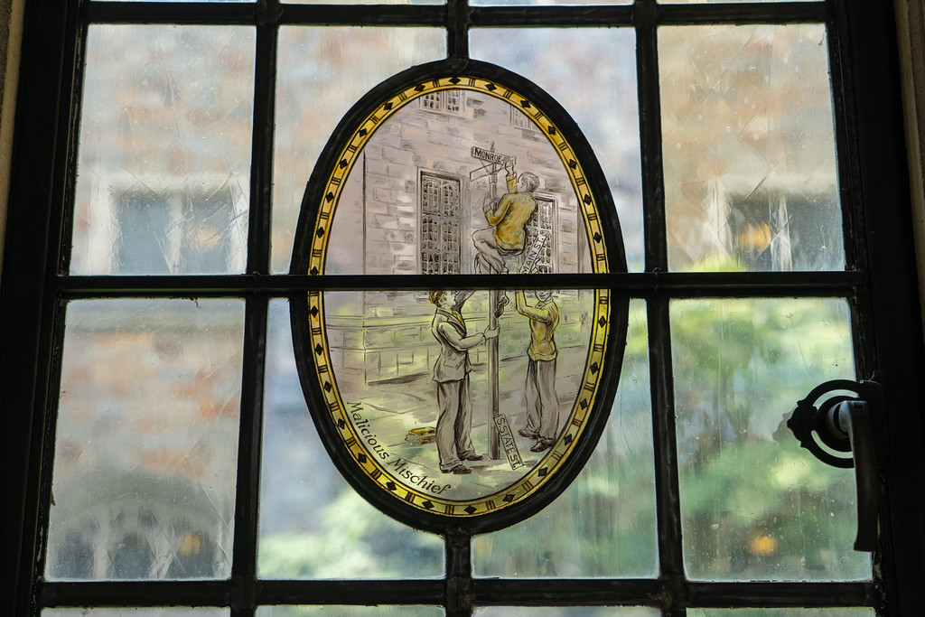 Painted glass window in Hutchins Hall