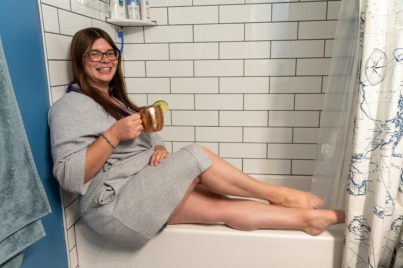 Amanda drinking in the bathroom