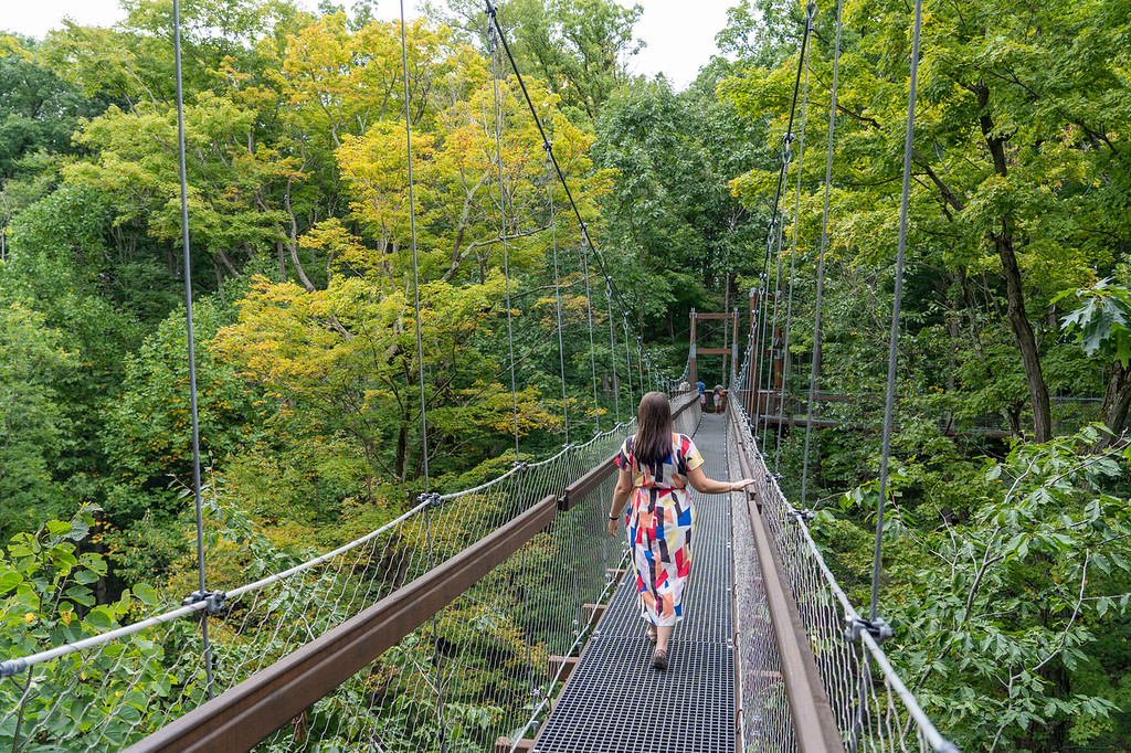 Girl in a dress on the Canopy Walk at Holden Arboretum in Ohio
