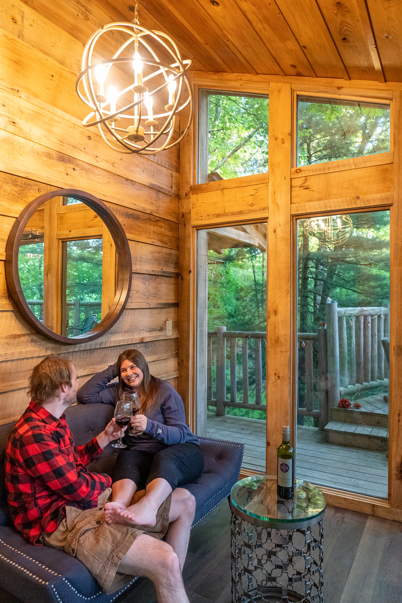 Amanda and Elliot drink wine in the tree house The View