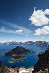Amazing landscape at the Crater Lake. Love the shadow of the cloud on the symbolic emerging hill (so-called Wizard Island) bringing drama to the scene.