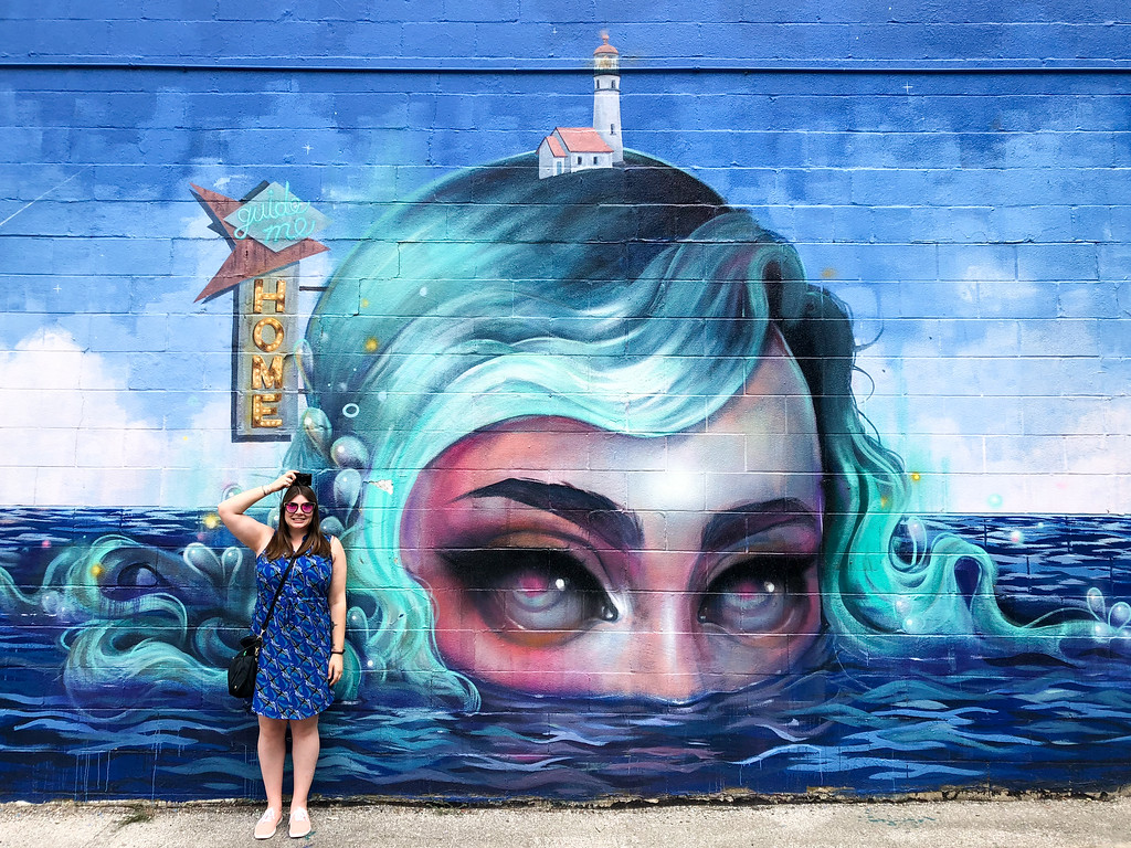 Posing with a mural in Austin