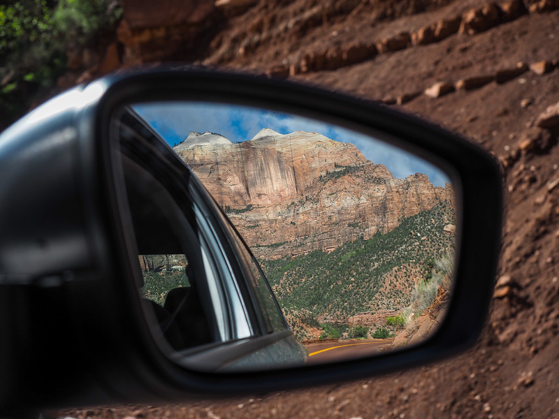 Mount Carmel Highway in Zion National Park in a rearview mirror