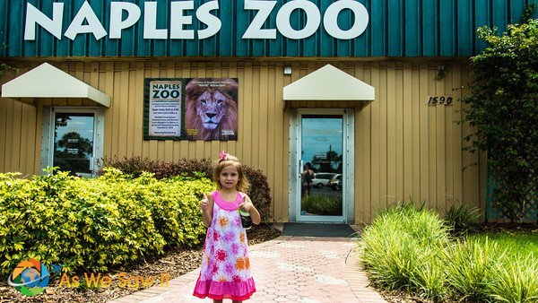 Finally getting her turn for a picture, Leia poses in front of the Naples Zoo entrance...