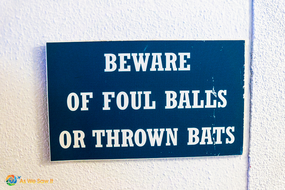 Warning sign in Tropicana Field, Beware of foul balls or thrown bats.