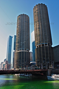 The Marina Towers overlooking a dyed green Chicago River around St. Patrick's Day in Chicago.