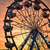 Ferris Wheel Through Golden Hour Sunset