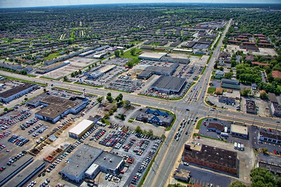 Aerial photo of Highland, Indiana near the intersection of Indianapolis Blvd (US 41) and 45th St. Featured in this photo are many car dealerships including Christenson Chevrolet, Webb Ford, Bosak Honda, Circle Buick GMC, Thomas Kia and several other businesses in the area.