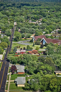 Aerial photo of South Side Christian Church in Munster, Indiana. Broadmoor Ave is seen running from west (bottom) to east (top)