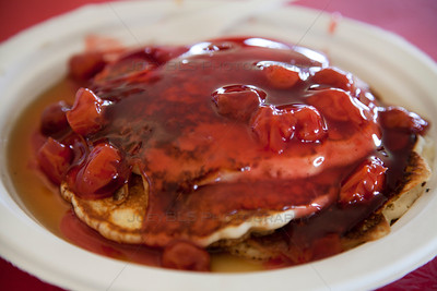 Pancakes Covered with Cherries