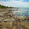 The rocky shores of Lake Michigan at Toft Point State Park in Door County, Wisconsin near Baileys Harbor. Photo taken in June 2012.