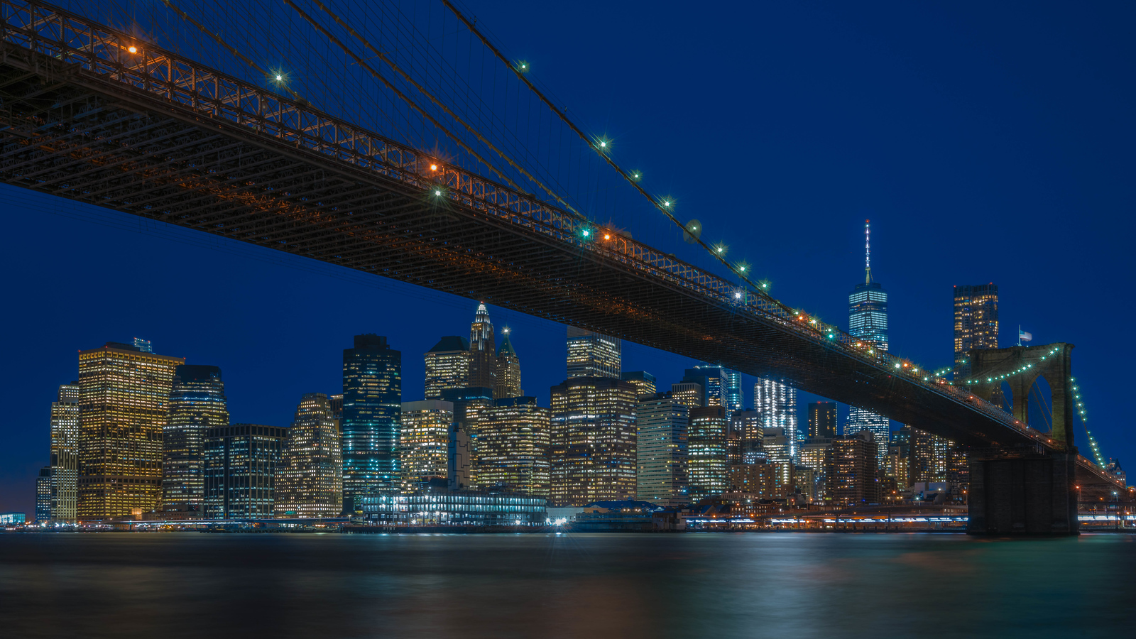 The Manhattan Bridge at night.