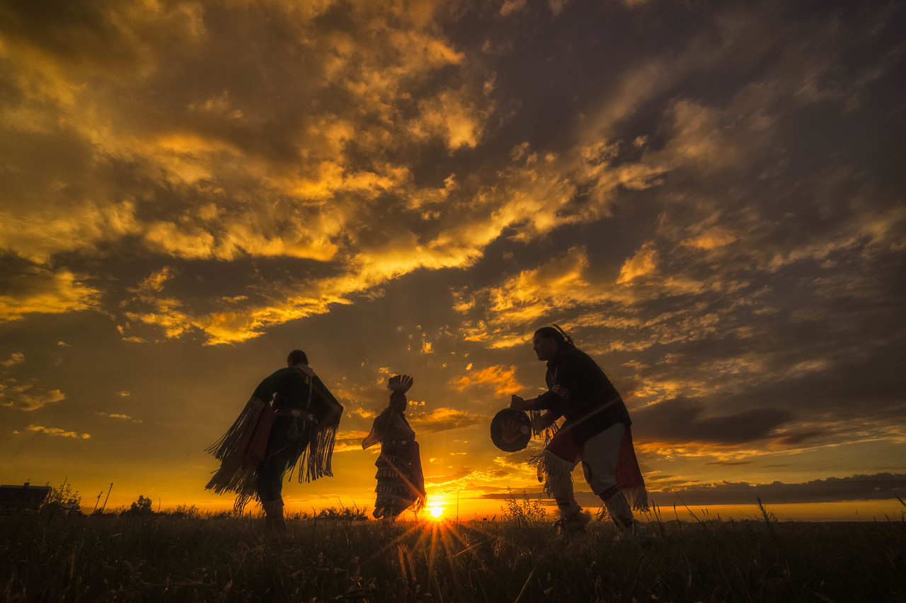 A Lakota traditional dance at sunset in South Dakota.