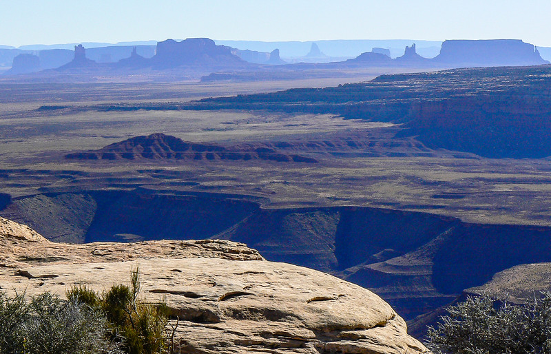 Desert view with spires of Monument Valley in the distance