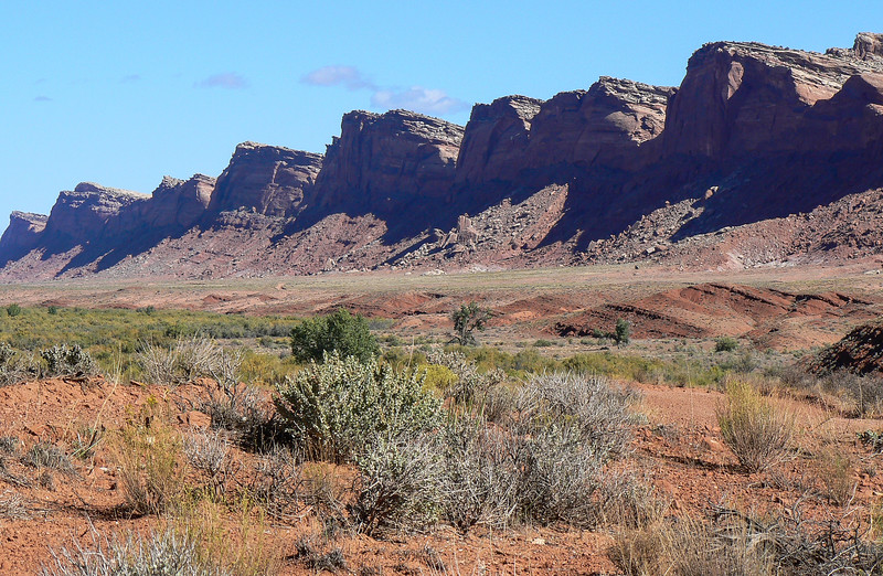 A series of rocky cliffs join together into one ridge in southeastern Utah.