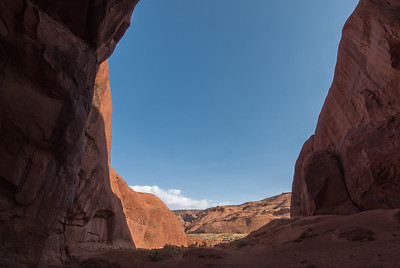 In between two giant buttes in Monument Valley, Utah