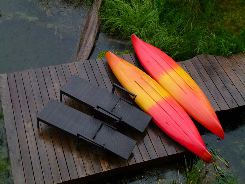 Kayaks and lounge chairs wait to be used at Inn the Estuary on Vancouver Island.