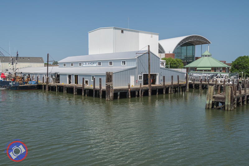 The Old Fish Processing Plant Against a Backdrop of the Air and Space Museum and the Hampton Carousel (©simon@myeclecticimages.com)