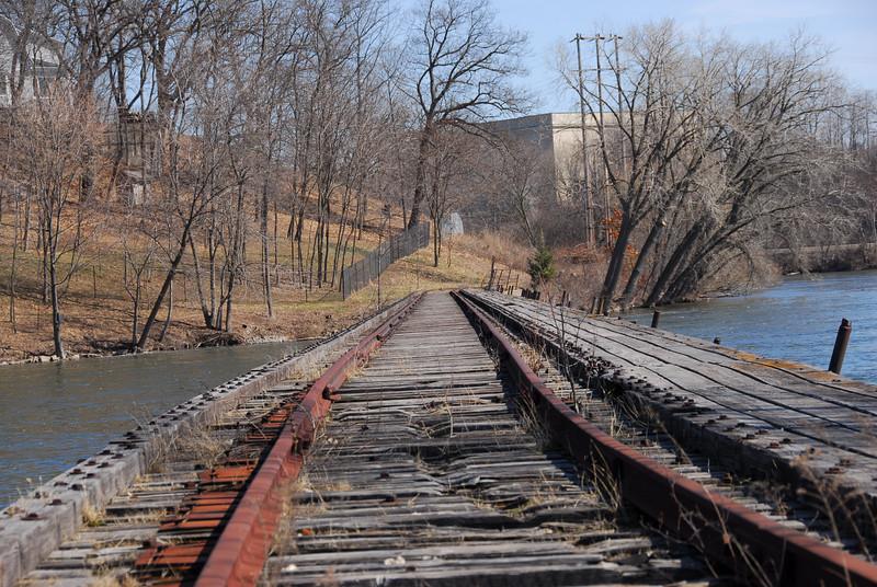 Crossing the wooden bridge in Fox River, Appleton, Wisconsin