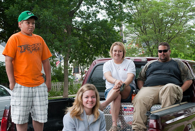 Family on the back of the truck witnessing Appleton Flag Day Parade