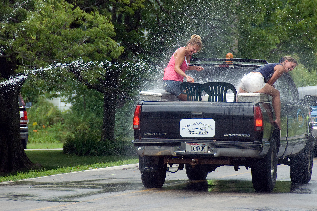 Water hose aimed at women in truck - Stephensville, Wisconsin