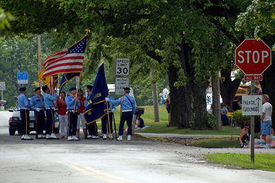 Holding the state and US flag at Stephensville Parade, Wisconsin