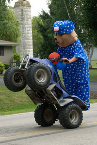 Mascot riding a quad bike in Stephensville Parade, Wisconsin