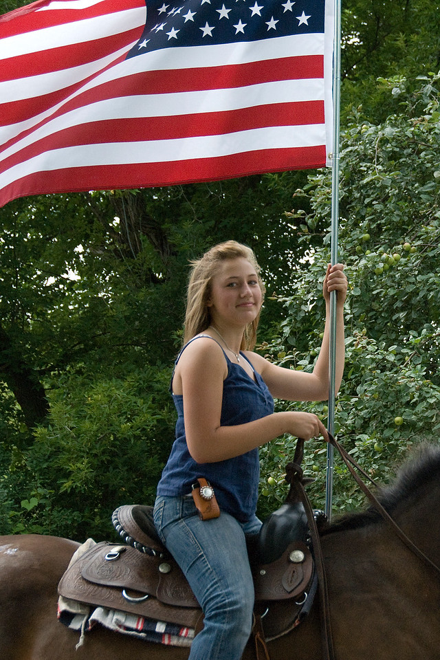 Horseback rider holding US flag in parade - Stephensville, Wisconsin