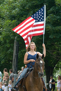 Horseback rider holding US flag in parade - Stephensville, Wisconsin