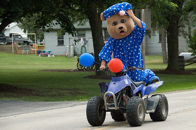 Mascot riding a quad bike at Stephensville Parade, Wisconsin