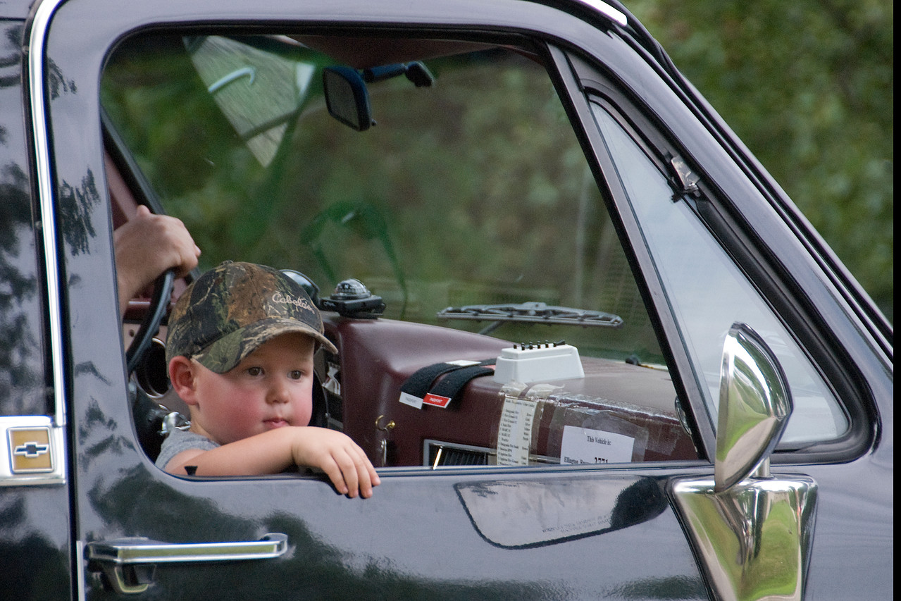 Boy inside a truck in Stephensville Parade, Wisconsin