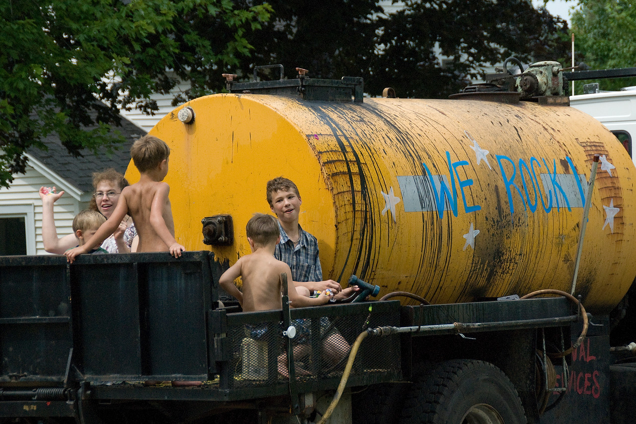 Boys in a water truck in a parade in Stephensville, Wisconsin