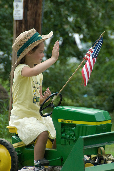 Girl holding a flag in a parade in Stephensville, Wisconsin