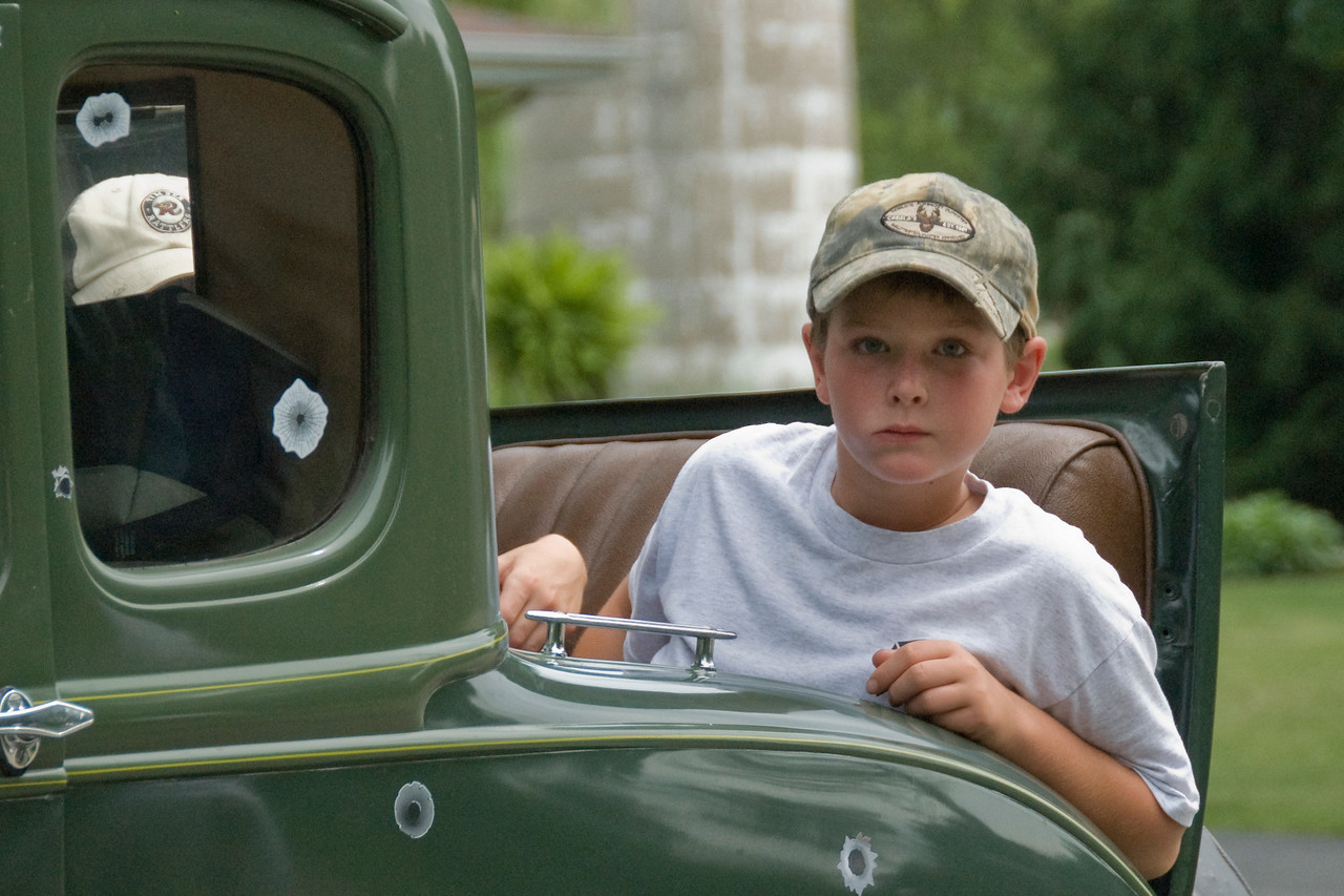 Boy in a vintage car in Stephensville Parade, Wisconsin