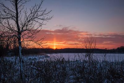 Milwaukee, Wisconsin Sunset over frozen Mud Lake.