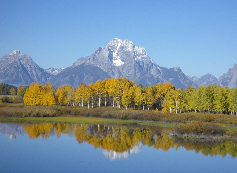 Autumn colors at Oxbow Bend is part of the fall travel fun on a visit to Grand Teton National Park, Wyoming.