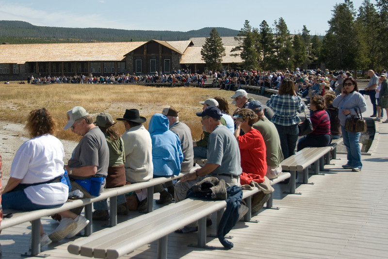 Tourists watching the Old Faithful Geyser, Yellowstone National Park